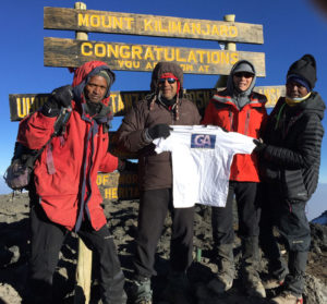 Bill Singh on top of Mt Kilimanjaro